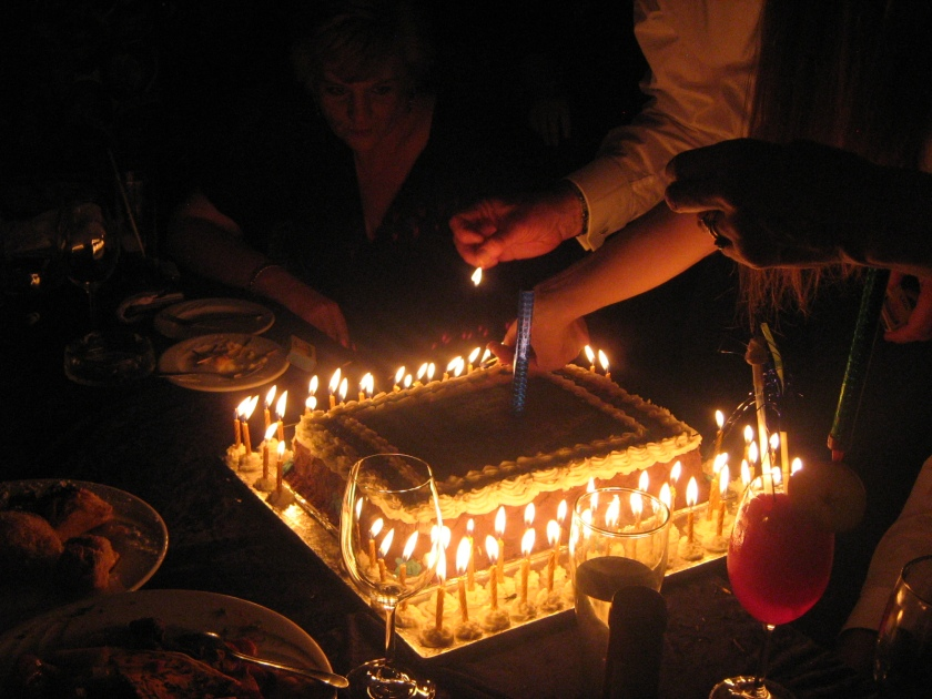 lighting candles on a 60th birthday cake