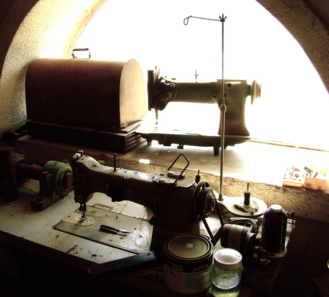 old sewing machines in upholsterers workshop
