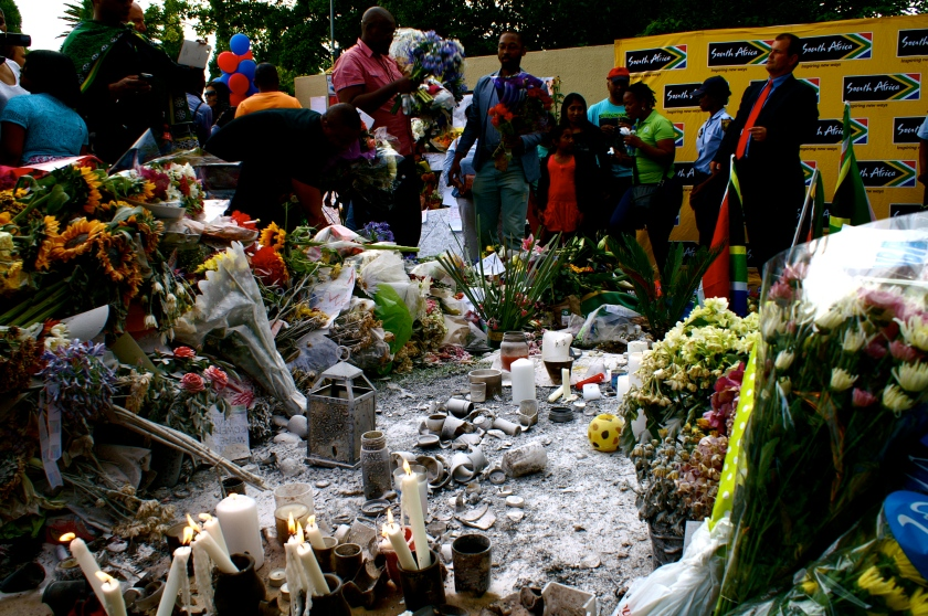 Flowers and candles for Mandela outside Mandela Houghton residence