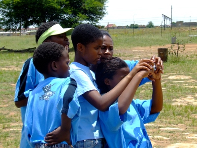 school kids in Orlando, Soweto, learning the basics of photography.