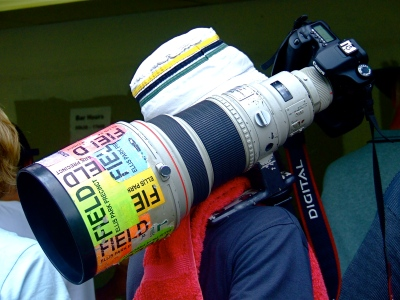 sports photographer with long lens